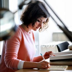 Photograph of a student writing an application