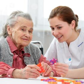 Photograph of elderly person receiving care